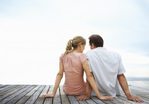 Couple sitting on a jetty